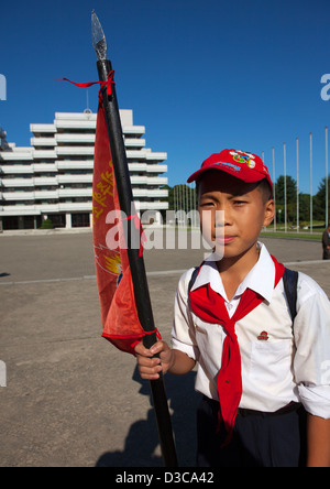 Pioneer Holding A Flag At Songdowon International Children's Camp, Wonsan, North Korea, North Korea - Stock Photo