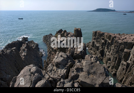 Sunny day horizon view of the Nihonkai, or Sea of Japan, from atop the jagged, rocky coastline of Tojinbo, Fukui, - Stock Photo