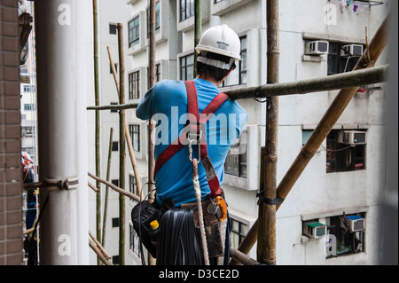 Bamboo scaffolding built up around the Kiu Fat Building ,still being used for its durability, lightness and flexibility. - Stock Photo