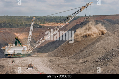 Immense drag line working and digging in open cut coal mine in central Queensland Australia - Stock Photo