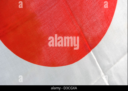 The Japanese flag is known as the hinomaru, or circle of the sun, or rising sun. A red circle against a white background. - Stock Photo