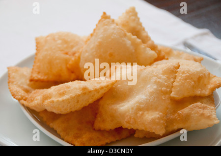 Fried pastries made of phyllo (or yufka) filled with unsalted cheese mixed with sugar - Stock Photo