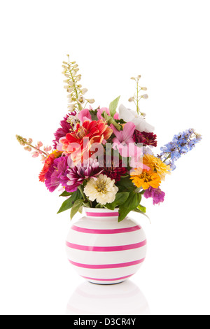Striped vase with mixed garden flowers - Stock Photo