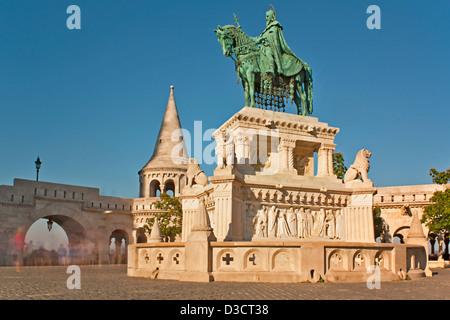 Long daytime exposure of Bronze Statue of Stephen I at Fishermans Bastion Budapest Hungary - Stock Photo