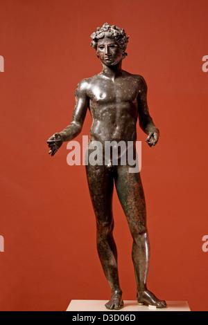 Roman Sculpture in Bronze El Efebo Municipal Museum Palacio de Najera Antequera Malaga Andalusia Spain - Stock Photo