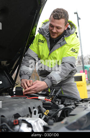 ADAC road patrol driver Kai Maier shows how to short a car battery in Leonberg, Germany, 05 February 2013. Krämer - Stock Photo