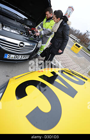 ADAC road patrol driver Kai Maier (L) shows how to short a car battery in Leonberg, Germany, 05 February 2013. Krämer - Stock Photo