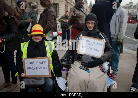 Women hold placards at fuel poverty action outside the Department of Energy & Climate Change office in Whitehall, - Stock Photo