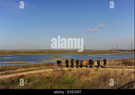 Birdwatchers or twitchers at Rainham Marshes RSPB Nature Reserve by the River Thames Essex UK - Stock Photo