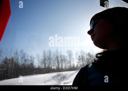 Niekoping, Sweden, a young woman looks out the window of an overland bus - Stock Photo