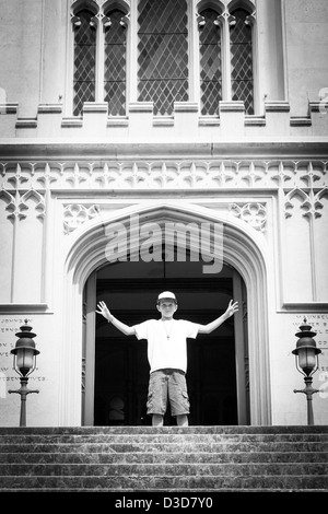 A boy in the doorway of the Old Louisiana State Capitol Building - Stock Photo