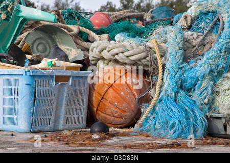 Marine debris brought to Midway Atoll shores by ocean currents then collected to be shipped off island for recycling or disposal