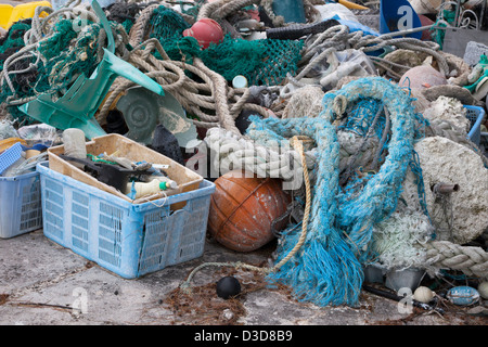 Marine debris brought to Midway Atoll by currents then collected to be shipped off island for recycling or disposal