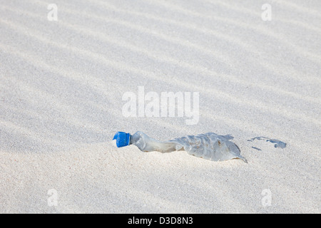 Plastic bottle washed ashore on the beach of a remote island in the North Pacific ocean - Stock Photo