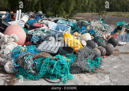 Marine debris brought to Midway Atoll by ocean currents then collected to be shipped off island for recycling or disposal
