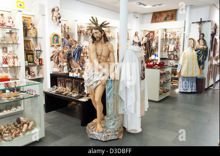 Figure of Jesus Christ in Belloso, a shop selling Christian merchandise, Madrid, Spain - Stock Photo