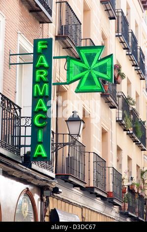Pharmacy sign, Madrid, Spain - Stock Photo