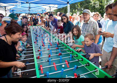 Bochum, Germany, people are playing on a giant foosball table on the Still Life Ruhr - Stock Photo