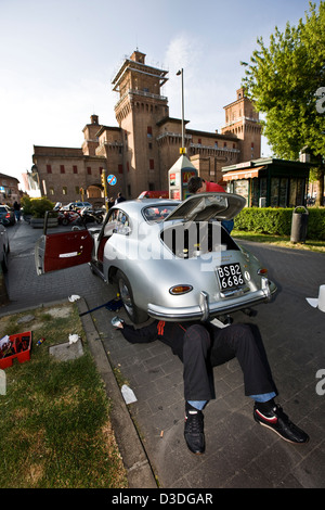 Mechanics working on Porsche, Mille Miglia car race, Italy, 2008 - Stock Photo