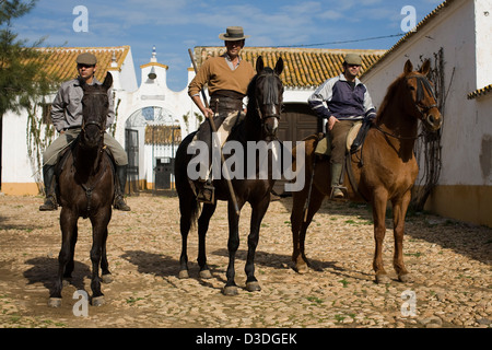 LA RUIZA FINCA, HUELVA, SPAIN, 21st FEBRUAY 2008: Don Tomas Prieto de la Cal, 41, (centre) sets off with two cowboys - Stock Photo
