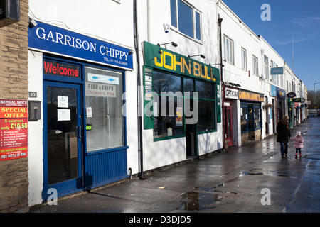 Food Shops, Business Services, and street businesses in Hildyard Row, Catterick Garrison; catering for the adjacent - Stock Photo