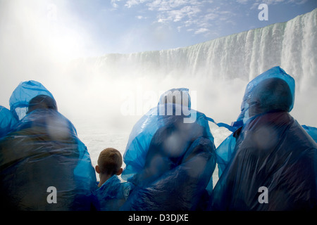 Niagara Falls, Canada, tourists in front of the Horseshoe Falls on the Canadian side - Stock Photo