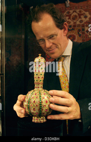 LONDON, ENGLAND - MARCH 2004: Christie's expert William Robinson with the 'Magnificent Mughal ruby and emerald inset - Stock Photo