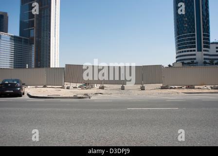 The facade of a construction site in Dubai, United Arab Emirates. - Stock Photo