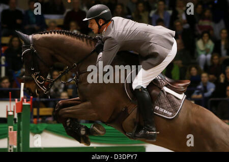 German showjumper Marco Kutscher jumps on his horse 'Cornet's Cristallo' during the internation showjumping Grand - Stock Photo
