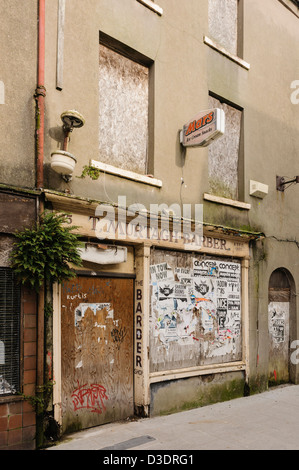 Old derelict barbers shop - Stock Photo