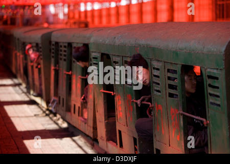 XIMING COAL MINE, TAIYUAN, CHINA - AUGUST 2007: Miners wait inside the narrow guage electric trains that will take - Stock Photo