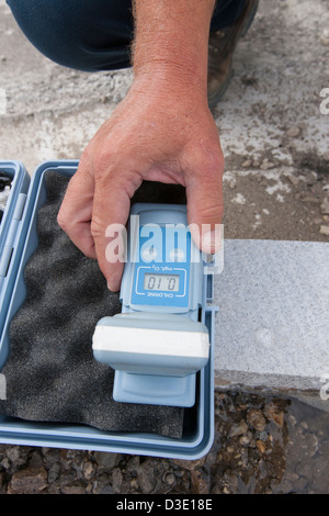 Engineer working with chlorine monitor in water sample - Stock Photo