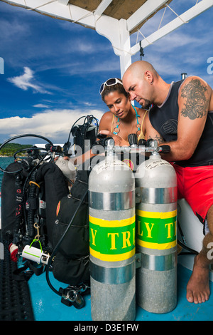 Scuba divers create dive plan on boat before beginning technical dive - Stock Photo