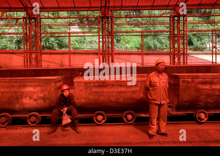 XIMING COAL MINE, TAIYUAN, CHINA - AUGUST 2007: Miners wait for the narrow guage electric trains that will take - Stock Photo