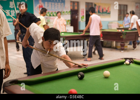 PU LIAN TA COAL MINE, ORDOS, INNER MONGOLIA, CHINA - AUGUST 2007:  Off-duty miners play pool in a recreation hall - Stock Photo