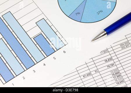 Graphs in Blue with Spreadsheet and Pen - Stock Photo