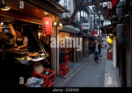 Unchanged since 1950's a narrow alley called Omoide Yokocho, or Memory Lane, in Shinjuku, Tokyo is packed with small - Stock Photo
