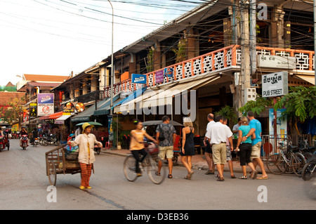 Tourists and locals looking for restaurants and bars in the famous Pub Street, Siem Reap, Cambodia - Stock Photo