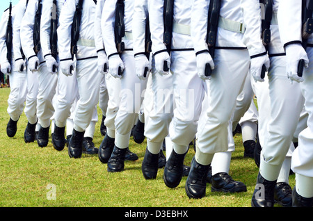 New Zealand Military Navy soldiers carry guns and march in a row during an army parade - Stock Photo