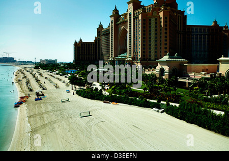 The Atlantis Palm Hotel in Dubai as seen from the monorail with the beach in front for sunbathers - Stock Photo