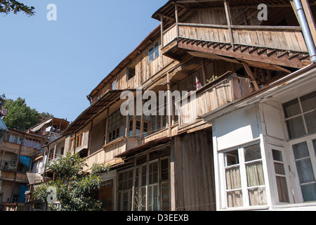 ood houses with wooden balconies in Tbilisi, Georgia. - Stock Photo