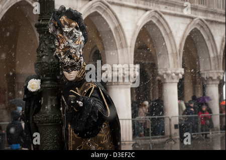 A person wearing mask at St. Mark's Square during carnival season in Venice, Italy. - Stock Photo