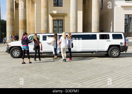 Hummer car near the Brandenburg Gate. - Stock Photo
