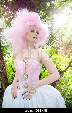 Pink ethereal mystical fantasy forest with a woodland nymph princess story fairy tale pixie elf showing adventure - Stock Photo