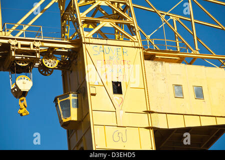 Serge Charnay, 43, gestures to people below from his position in a 40 metre high shipyard crane in Nantes, France, - Stock Photo