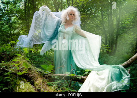 Green ethereal mystical fantasy forest with a woodland nymph princess story fairy tale pixie elf showing adventure - Stock Photo
