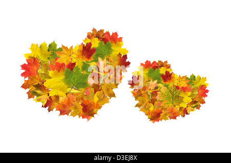 Two hearts from autumn maple leaves - Stock Photo