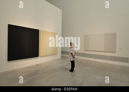 Germany, Berlin At Berlinische Galerie, woman looking some paints - Stock Photo