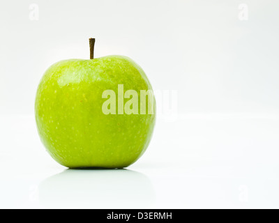 A fresh green apple isolated on white background - Stock Photo