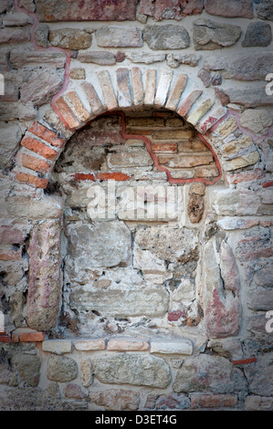 A bricked up window from a house in the ancient roman settlement of Side in Turkey - Stock Photo